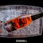 Bouteille dans seau à glace du champagne Minard et Filles